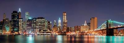 New York City - Manhattan Skyline Panorama with Brooklyn Bridge at Night