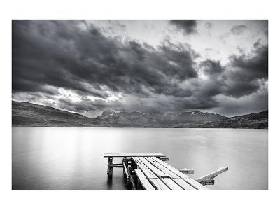 Lake with Dock Mountains & Clouds