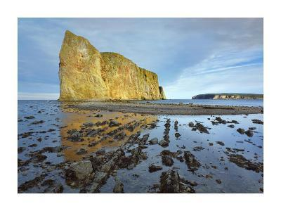 Coastline and Perce Rock, a limestone formation, at low tide, Quebec, Canada