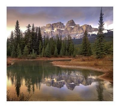 Castle Mountain and boreal forest reflected in lake, Banff National Park, Alberta