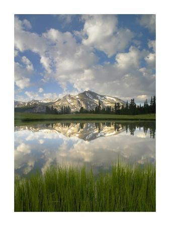Mammoth Peak and scattered clouds reflected in lake, Yosemite National Park, California