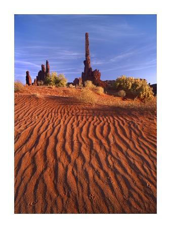 Totem pole and Yei Bi Chei with sand dunes, Monument Valley, Arizona