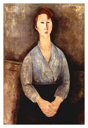 Seated woman with grey blouse