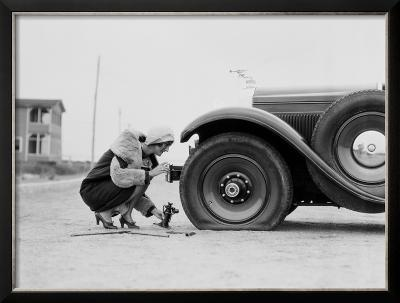Woman Changing Flat Tire on Car
