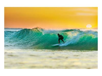 Sunrise Surfing Breeaking Wave