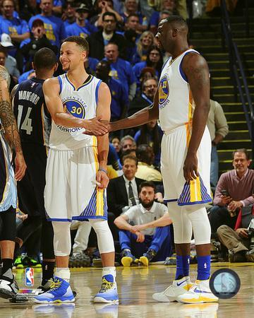 Stephen Curry & Draymond Green during the Golden State Warriors NBA record 73rd win of the season-