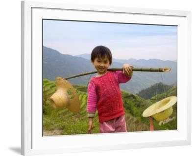 Young Girl Carrying Shoulder Pole with Straw Hats, China