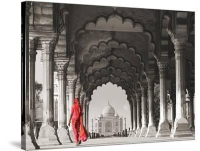 Woman in traditional Sari walking towards Taj Mahal (BW)