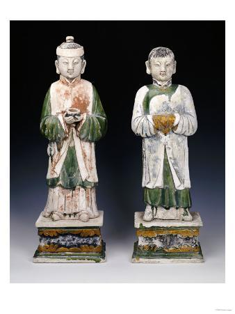 An Unusual Pair of Glazed and Painted Pottery Figures of Attendants