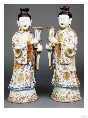 A Pair of Famille Rose Candle Holders Modelled as Standing Ladies, Qianlong