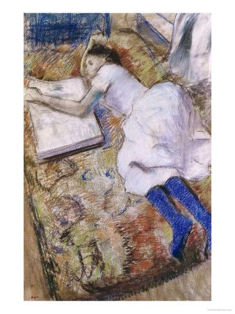 A Young Girl Stretched Out and Looking at an Album