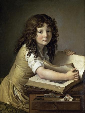 A Young Child Looking at Figures in a Book