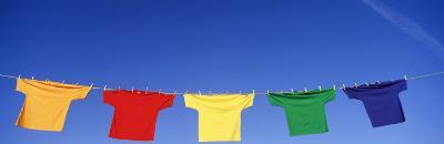 Low Angle View of T-Shirts Hanging on a Clothesline