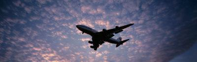 Boeing 747 Airplane in Flight Against Evening Clouds