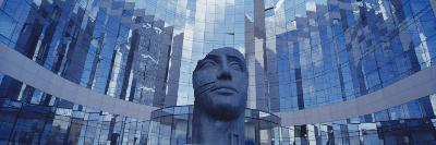 Low Angle View of a Statue in Front of Building, La Defense, Paris, France