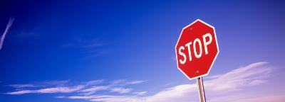 Stop Sign Against Sky