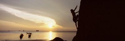 Silhouette of a Man Climbing a Rock, Railay Beach, Krabi, Thailand