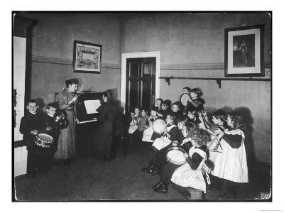 Music Lesson at a German School. One Teacher Plays the Piano