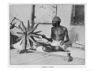 Mahatma Gandhi Indian Nationalist and Spiritual Leader Spins at a Wheel in 1931