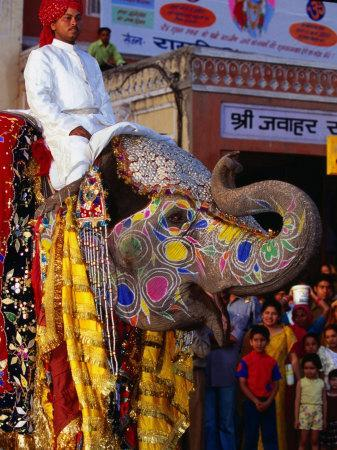 Man Riding Decorated Elephant In Street Parade Of Annual