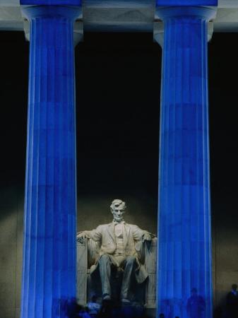 Abraham Lincoln Statue Between Blue Floodlit Columns of Lincoln Memorial, Washington Dc, USA