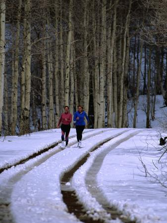 Women Jogging in a Wintery Park City, Park City, Utah, USA