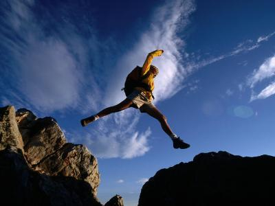Hiker Jumping Between Rocks in the Wasatch Mountains, Wasatch-Cache National Forest, Utah, USA