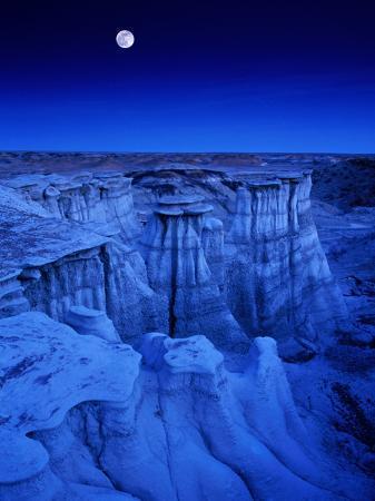 Full Moon Rises Over Landscape in De-Na-Zin Wilderness, Bisti Badlands, New Mexico, USA