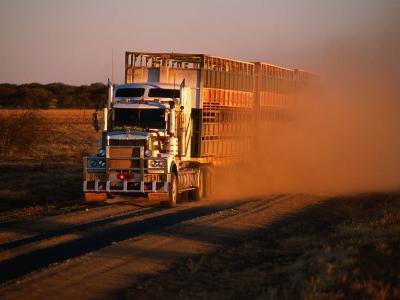 Road Train Driving along Dusty Road, Kynuna, Australia