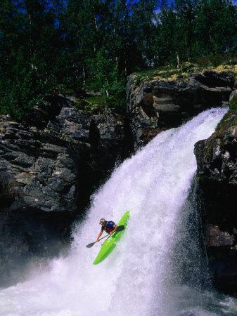 Kayaker Going Down Waterfall of Store Ula River, Rondane National Park, Norway