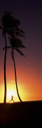 Silhouette of a Woman Running on the Beach, Magic Island, Hawaii, USA