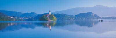 Reflection of Mountains and Buildings in Water, Lake Bled, Slovenia