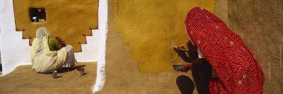 Two Women Painting on a Wall, Khuri, Thar Desert, Jaisalmer, Rajasthan, India