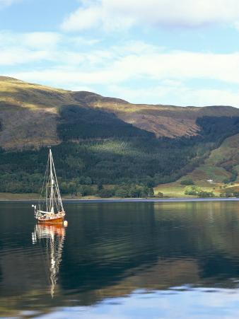 Wooden Yacht on Loch Leven, in Autumn, Glencoe, Highland Region, Scotland, United Kingdom