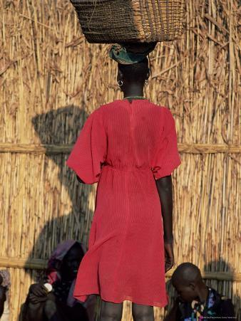 Back View of a Nuer Woman Carrying a Wicker Cradle or Crib on Her Head, Ilubador State, Ethiopia