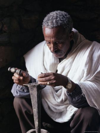 Portrait of a Blacksmith at Work, Town of Axoum (Axum) (Aksum), Tigre Region, Ethiopia, Africa