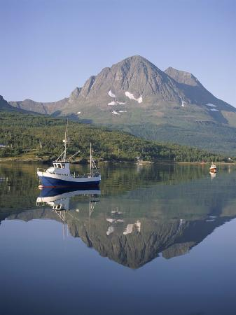 Boat and Mountains Reflected in Tranquil Water, Near Tromso, North Norway, Norway