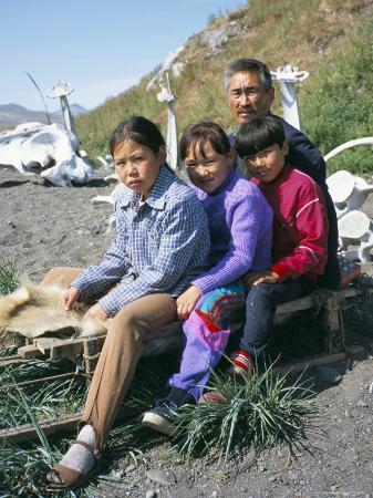Eskimos, Sledge and Whale Bones at Yanrakino Village, Chukchi Peninsula, Russian Far East, Russia