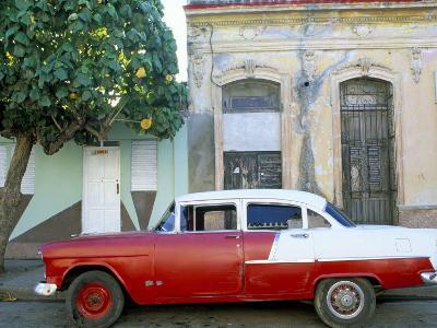 Old American Car Parked on Street Beneath Fruit Tree, Cienfuegos, Cuba, Central America