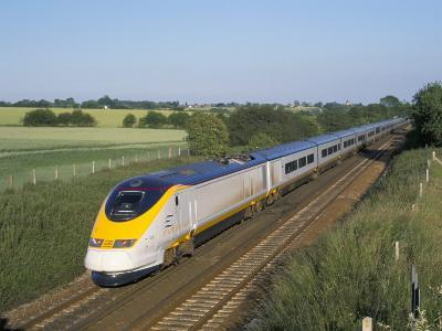 Eurostar Train Travelling Through Countryside