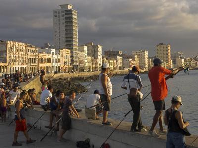 Men Fishing at Sunset, Avenue Maceo, El Malecon, Havana, Cuba, West Indies, Central America