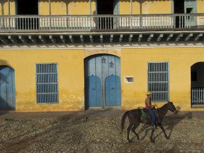 Man Riding Horse Past the Galeria Del Arte (Art Gallery), Plaza Mayor, Trinidad, Cuba