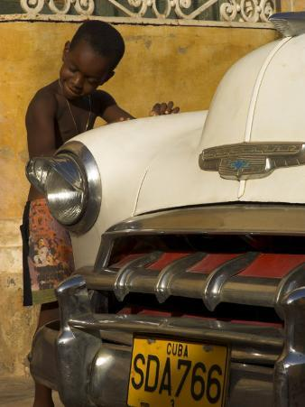 Young Boy Drumming on Old American Car's Bonnet,Trinidad, Sancti Spiritus Province, Cuba