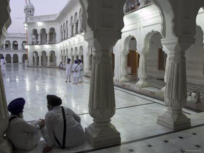Two Sikhs Priests at Dawn Sitting Under Arcades, Golden Temple, Amritsar, Punjab State, India
