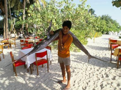 Boy Carrying Freshly Caught Swordfish, Embudu, the Maldives, Indian Ocean