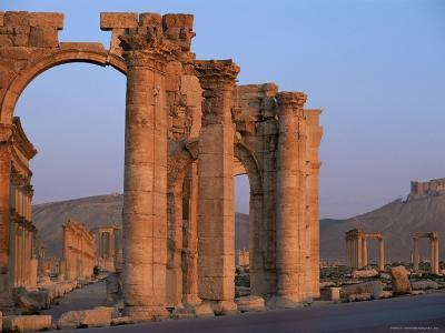 Monumental Arch at Archaeological Site, with Arab Castle Beyond, Palmyra, Syria