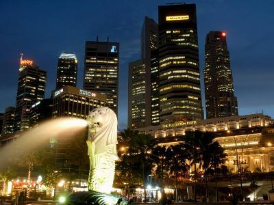 Merlion Fountain with Statue of Half Lion and Fish, with City Buildings Beyond, Southeast Asia