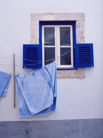 Laundry Hanging on Line at Window in the Moorish Quarter of Alfama, Lisbon, Portugal