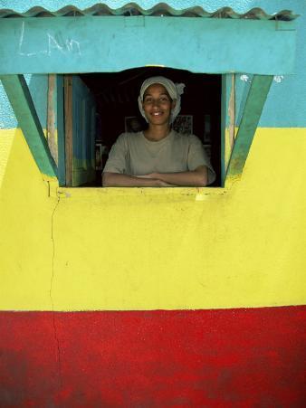 Woman in Window of Rasta Coloured Shop, Sheshamane, Ethiopia, Africa