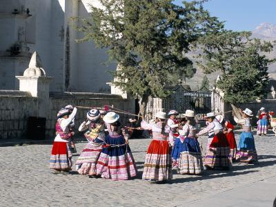 Girls in Traditional Local Dress Dancing in Square at Yanque Village, Colca Canyon, Peru